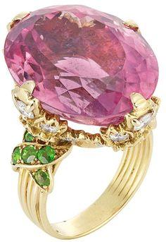 Gold, Pink Tourmaline, Diamond and Demantoid Garnet Ring   One oval pink tourmaline ap. 21.50 cts., 24 round diamonds ap. 1.80 cts.,10 round demantoid garnets, ap. 8.3 dwt. Size 6 1/4.
