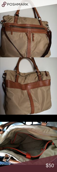 """Banana Republic Tote with Laptop section Great tote for work! Gently used beige Banana Republic laptop tote. Real leather trim and orange piping internally. Separate laptop section with snap closure, interior wall zippered pocket and two slip pockets perfect for a phone. Three front zippered pockets and pocket on the back side. There's two shoulder handles and a detachable, adjustable shoulder strap. 13"""" H x 15"""" L x 5"""" D. Comes from a smoke free home. Banana Republic Bags Totes"""