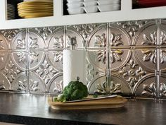 Give your kitchen a stunning, stylish upgrade with metallic-finish tiles. This DIY project requires just a few standard tools and not a lot of money.