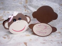 Cut out monkey baby shower invitations with button eyes
