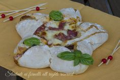 ricetta stella di pizza farcita con prosciutto crudo e mozzarella ricetta per natale centrotavola