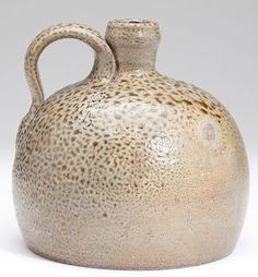 NC Pottery Jug of Unusual Form salt glazed stoneware with J. F. Brower Masonic stamp to the right of the handle and with stamped capacity of 1/2 as well, turned by Himer Fox for the merchant John Brower.7 x 6.5 in.