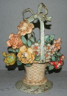 Cast iron door stop of basket of flowers.