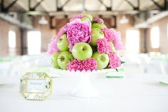 Pink & apple milk glass centerpiece  Courtesy of Perez Photography Austin and Dallas Wedding Planner Altar Ego Weddings Filter Building