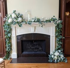 Decor used for backdrop of ceremony in home.  With emphasis on top left and bottom right with white and greenery florals.