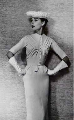 1956 Model in crêpe cocktail dress by Jacques Fath
