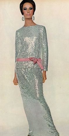 1965 Bettina Lauer in Norman Norell's sleek silk jersey skirt and blouse covered in silver paillettes, tied with a pink satin bow, photo by Penn for Vogue