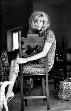 Love this dining chair and looking over the back. Lit from the front. Monica Vitti