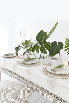 Alabaster Trader's block printed palm tablecloth and tableware creates a modern, tropical theme. Photography/Styling by Villa Styling.