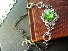 HegemoneSwarovski peridot green rivoli crystal antique by UpBrass, $30.00