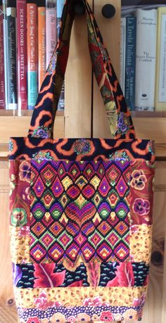 "https://flic.kr/p/nNTFdr | 765P5288516 | No. 765 Anna'a Bag Customer's needlepoint Kaffe Fassett ""Lille Collection"". Kaffe Fassett ""Pansy"". Kaffe Fassett ""Peking"". Kaffe Fassett ""Embroidered Leaf"".  ""Samarkand"". Martha Negley ""Chard""."