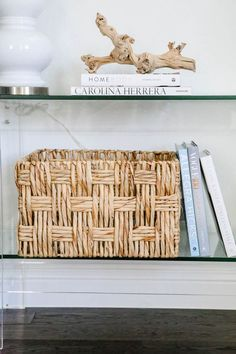 Rattan basket, coffee table books, coastal decor, entryway decor. #entryway #summerdecor #ABlissfulNest Deeper Shade Of Blue, Light Blue Color, Sisal, Lavender Color Scheme, Styling Bookshelves, Acrylic Table, Coffee Table Books, Fireplace Mantle, Ginger Jars