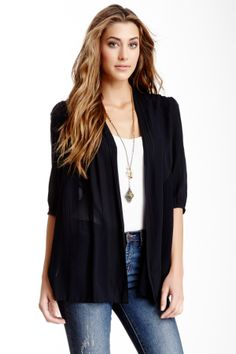 a tucked in tank with an over-shirt or blazer adds a polished look.