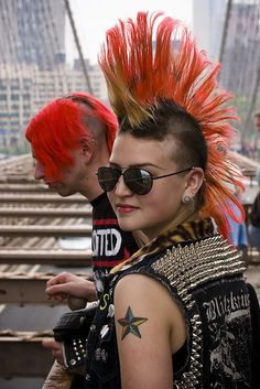 Male and female punks, red mohawks