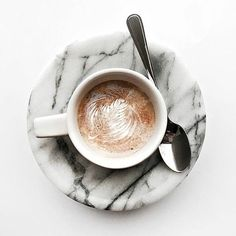 {Morning cup on marble. Happy Tuesday!}