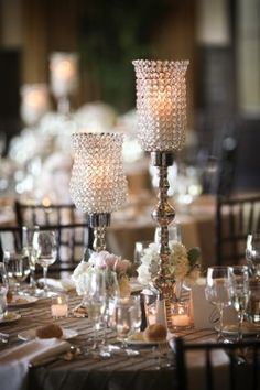 Love. Love. Love these hurricane crystal candle holders along with the small vases of flowers. Definitely a centerpiece contender--maybe half floral arrangements and half with these.