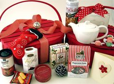 Great Christmas Gift Basket idea - you don't have to use everything shown. How about a fun teapot, a cute tea cozy, a Christmas spice tea, and cookies. The ideas are endless.