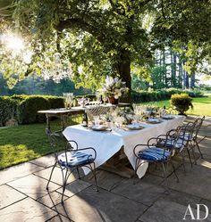 outdoor terrace garden hanging chandelier from tree ideas dining table set up under tree