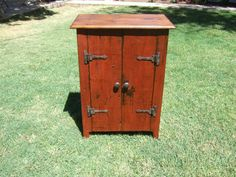 The Old Carrington Cabinet handmade with reclaimed barn wood and painted with eco-friendly Salem Red milk paint