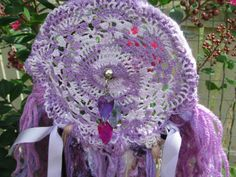 Dreamcatcher Wall Hanging -Purple Heart- made with novelty yarn in various shades of purple and violet with a beautiful vintage doily in web. $25.00, via Etsy.