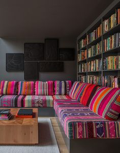 I probably would do neutral cushions and colorful pillows. Love the built in couch and storage space though.