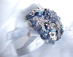 Blue Brooch Bouquet. This would be beautiful for beach wedding.