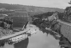 The Erie Canal is in New York and goes from Albany to Buffalo on the Hudson River. It was built so people could get from New York to the Great Lakes and the Atlantic Ocean. The canal was finished in 1825 and is still used today.