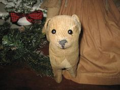 Straw stuffed corduroy dog with shoe button eyes and stitched nose.....
