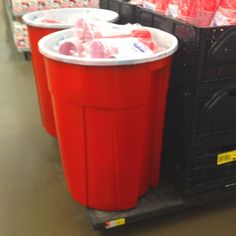 LOVE LOVE LOVE THIS !!!  OMG! The Giant Red Solo Cup!      1) Get a large trash can; 2) Get red and white paint; 3) Create!     Perfect for a drink bin!