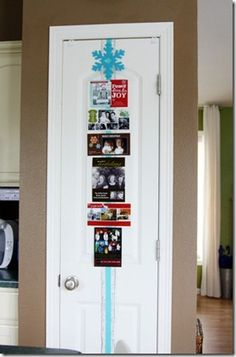 Christmas card holder. Ribbon on pantry door.