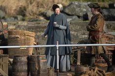 Caitriona sipped on a hot drink in a bid to stay warm during filming