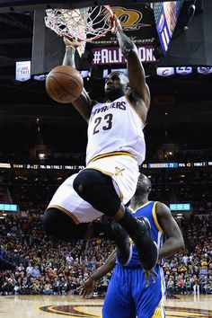 LeBron James Photos - LeBron James #23 of the Cleveland Cavaliers dunks the ball during the second half against the Golden State Warriors in Game 3 of the 2016 NBA Finals at Quicken Loans Arena on June 8, 2016 in Cleveland, Ohio. NOTE TO USER: User expressly acknowledges and agrees that, by downloading and or using this photograph, User is consenting to the terms and conditions of the Getty Images License Agreement. - 2016 NBA Finals - Game Three