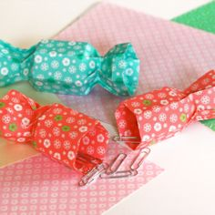 Make some origami boxes shaped like candies.