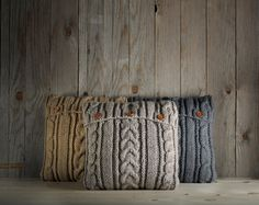Light gray-beige cable knit pillow cover with 3 wooden buttons. by Ideatobox on Etsy https://www.etsy.com/listing/207726250/light-gray-beige-cable-knit-pillow-cover