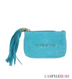 "Looking for a flashy pouch to hold the little stuff? Check out The Rich Gypsy Pouch by CC Skye. This pouch is big enough for cards and cash and with glam gold lettering of Rich Gypsy and an over the top suede tassel. If you love the style of this bag, you will love every piece from CC Skye!  * Width: 6.5"" x Height: 4.25"" x Depth: 0.25"" * 18K gold plated hardware"
