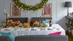 Panelled dining room with table set for a Christmas feast