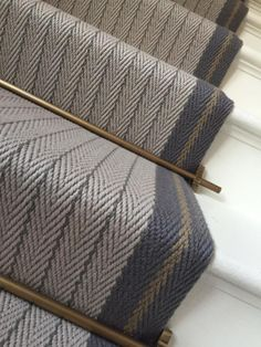 Our beautiful bespoke flatweave stairrunner in Claire Border in Graphite, Light Grey and Mushroom with antique brass stair rods. This is definitely one of our favourite bespoke creations. #hartleytissier #stairrunner #bespoke #wool