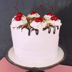 Split Personality- White Velvet Cake filled with banana, strawberry and pineapple topped with buttercream ganache pecans and cherries