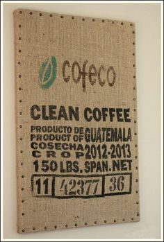 """Unique wall decor is what makes modern decorating style ideas so interesting. This is a burlap coffee bag that I stapled onto a canvas. I then took bronze nail heads and hammered them 2"""" apart. Now this was a cheap decorating idea!"""