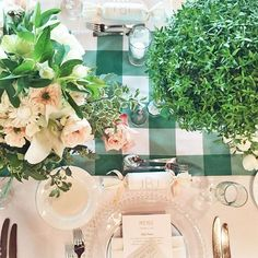 Garden inspired table settings from yesterday's Vegas wedding- Vintage silver vessels, mini myrtle tree topiaries, custom gingham table runners, and crepe paper poppers