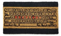 Get all QWERTY with this cool keyboard doormat.  Cost: $32