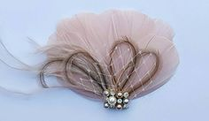 Check out this item in my Etsy shop https://www.etsy.com/listing/477470414/small-bridal-fascinator-mini-feather