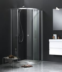 Nice contrast with dark walls and shower enclosure with our UNIQUE sliding door - is a classic in the bathroom