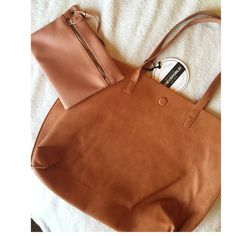 ✨ THE GREAT BROWN BAG ✨ This NWT brown purse is reversible! Has magnetic button to close at the top and attached small travel bag. BUNDLE AND SAVE Under one sky Bags Shoulder Bags