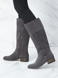The classic flat boot with a low stacked heel and knee-high construction. The Carlie boot also features an inner zipper for easy on and off wear. Shop now at Sole Society!
