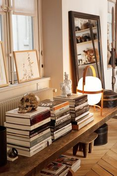 table / books / mirror