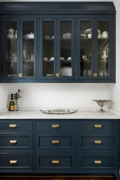 Navy cabinets look amazing with brass hardware and white carerra marble countertops, no doubt! But will they look dated years from now?Navy cabinets l Navy Kitchen Cabinets, Blue Cabinets, Painting Kitchen Cabinets, Pantry Cabinets, Upper Cabinets, Kitchen Paint, Colorful Kitchen Cabinets, Pantry Doors, Dining Room Cabinets