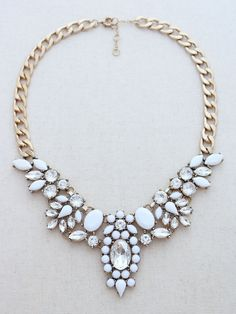 "♥ Super cute white and crystal statement necklace. Very chic and versatile. ♥ Easy to pair with a variety of outfits and looks. ♥ Approximately 20"" with 3"" extender."