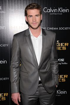 Liam Hemsworth rocked a stone grey one-button notch lapel suit from the Spring 2012 Calvin Klein Collection. Do you think he wore the right outfit at the NYC premiere. #ETCanada Photo: Getty