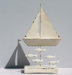 white tin boat with shoal of fish - click to view